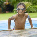 Boy in swimming pool- swimmers ear   Sacramento ENT