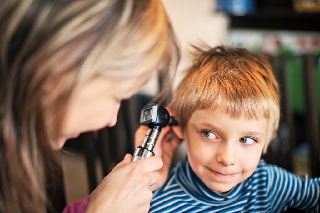 Young boy receiving ear check up- audiological evaluation