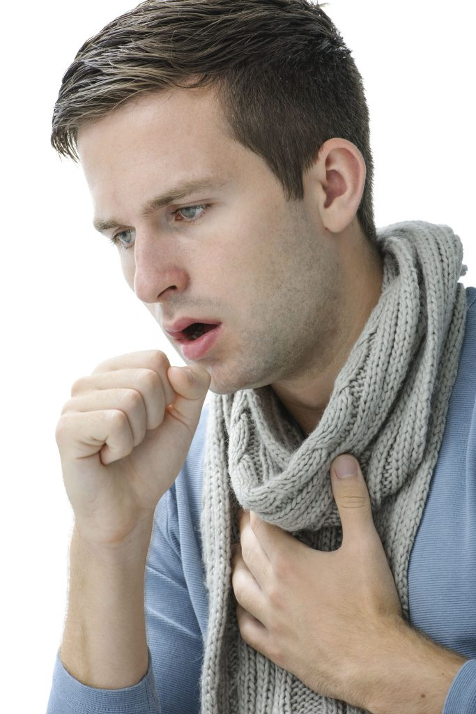 Man holding his chest and coughing - chronic hoarseness