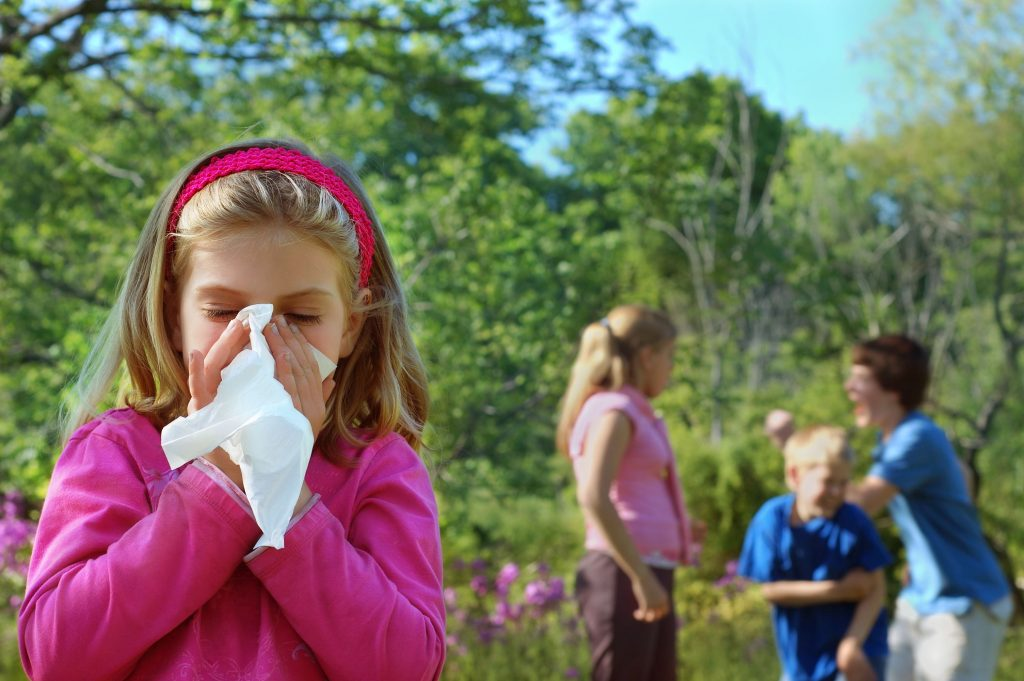 Young girl blowing her nose - Nasal congestion