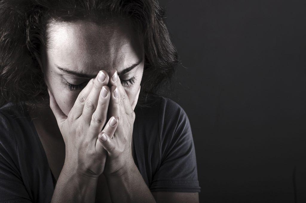 Woman holding her nose - nasal cavity trauma | Sacramento ENT