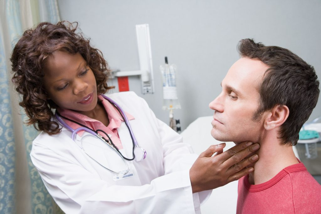 Female doctor examining patient - recurrent papilloma