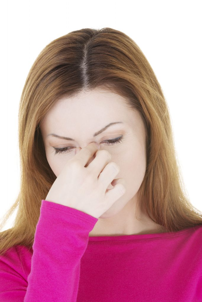 Woman holding her nose in pain - Sinusitis