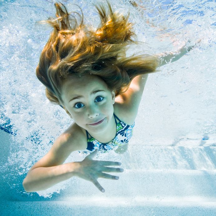 Young girl swimming in pool - Swimmers ear