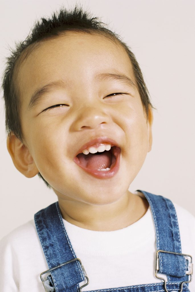 Child laughing - Pediatric Tonsillitis Adenoiditis