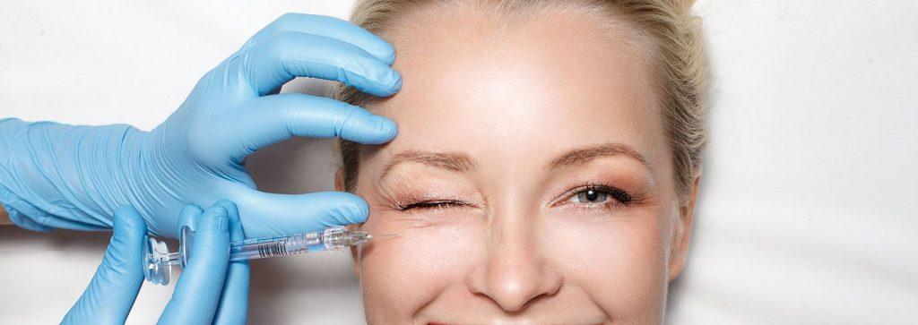 brow lift woman recieving injection on face