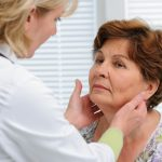 Doctor examining woman's neck- thyroid cancer awareness | Sacramento ENT