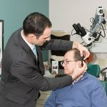 Doctor checking patients ears | Sacramento ENT